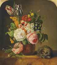 Roses, tulips, forget-me-nots, nasturtiums, jasmine, anenomes and other summer blooms in a classical urn by a snail and a bird's nest on a marble ledge