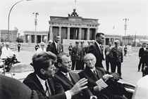 John F. Kennedy, Willy Brandt and Konrad Andenauer just leaving the Brandenburg Gate, Berlin, 1963