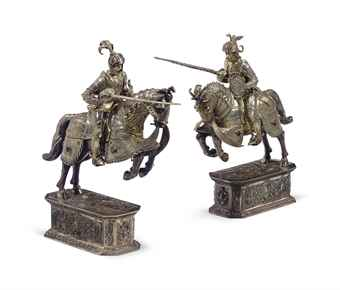 A PAIR OF GERMAN SILVER AND IVORY JOUSTING KNIGHTS