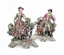 A PAIR OF BOW FIGURES OF A HUNTSMAN AND A LADY FALCONER