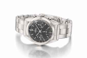 Rolex. A fine and rare stainless steel chronograph wristwatch with black dial and bracelet