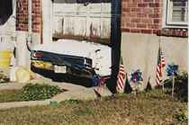 White Car Stuck in a Garage, New York, 2001