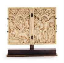 A carved ivory dyptich depicting the Nativity and the Crucif
