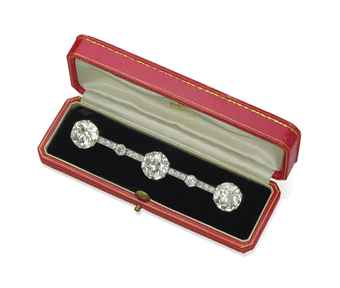 A DIAMOND BAR BROOCH, BY CARTIER