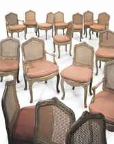 A SET OF SIXTEEN FRENCH GREEN-PAINTED AND CANED DINING CHAIR