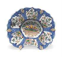 A DUTCH DELFT BLUE-GROUND BARBER'S BOWL