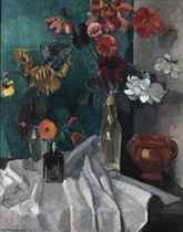 A still life with flowers in vases