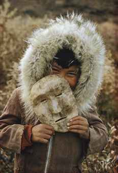 A Nunamiut Boy and Mask, Alaska, c. 1958