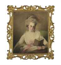 A young lady in a white dress with pink bows, seated at a table, reading a book