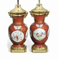 A PAIR OF CHINESE CORAL-GROUND FAMILLE ROSE BALUSTER VASES