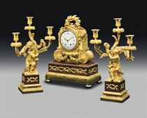 A FRENCH ORMOLU AND ROUGE GRIOTTE MARBLE THREE-PIECE CLOCK G