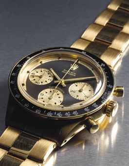 Rolex. An extremely attractive and probably unique 18K gold chronograph wristwatch with bracelet retailed by Hermes