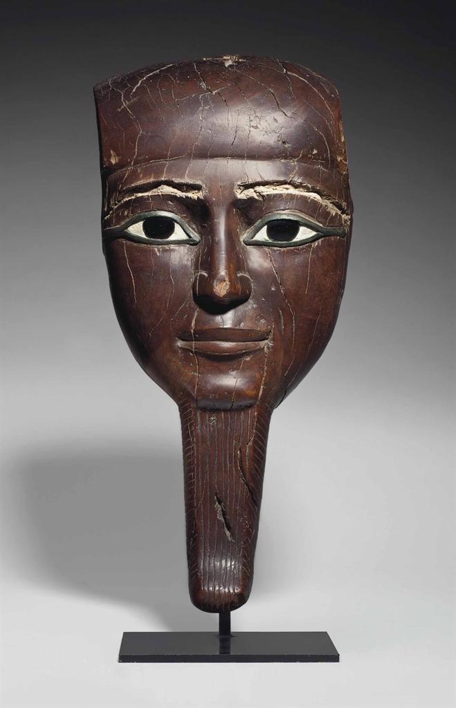 An Egyptian Wood Mask New Kingdom 19th 20th Dynasty
