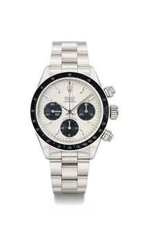 Rolex. A fine and rare stainless steel chronograph wristwatch with bracelet, original guarantee and box