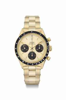 Rolex. A highly exclusive and attractive 14K  gold chronograph wristwatch with champagne dial, bracelet and brown subsidiary dials