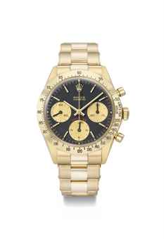 Rolex. An extremely rare and important 18K gold chronograph wristwatch with black dial and bracelet