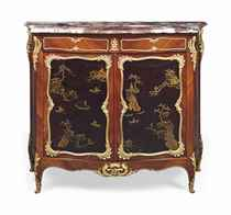 AN FRENCH ORMOLU-MOUNTED MAHOGANY AND BLACK LACQUER SIDE CABINET