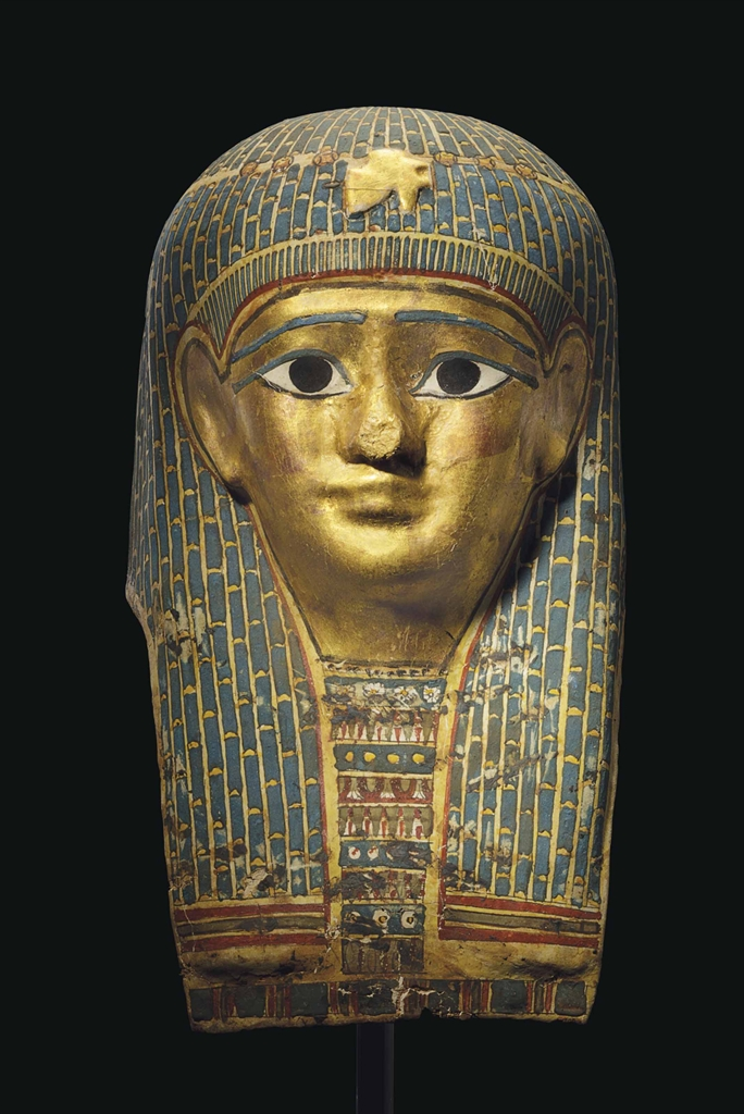 An Egyptian Gilt Cartonnage Mummy Mask Late Ptolemaic