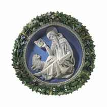 A POLYCHROME GLAZED CIRCULAR TERRACOTTA RELIEF OF ST JEROME
