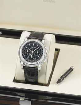 Patek Philippe. A fine, large and rare platinum perpetual calendar chronograph wristwatch with moon phases, additional case back and original Certificate