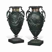 A PAIR OF LARGE VICTORIAN GREEN-PAINTED CAST-IRON URNS