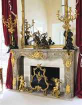A LARGE AND IMPORTANT FRENCH ORMOLU AND PATINATED BRONZE-MOUNTED SARRANCOLIN MARBLE FIRE-SURROUND