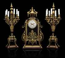 A NAPOLEON III ORMOLU AND ROUGE GRIOTTE MARBLE CLOCK GARNITURE