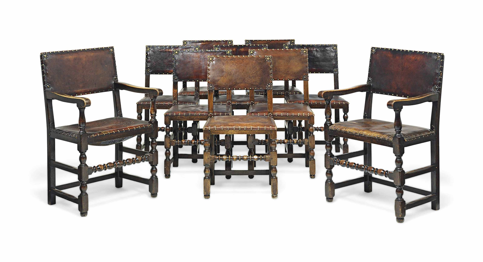 A set of ten oak and studded leather dining chairs seven for Studded dining room chairs