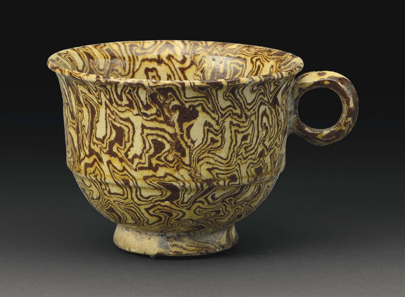 Tang Dynasty Pottery A RARE YELLOW-GLAZED M...