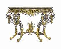 A FINE FRENCH ORMOLU AND POLISHED STEEL CONSOLE TABLE
