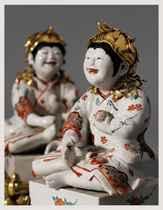 A Pair of Kakiemon Models of Karako (Chinese Boys) Seated on