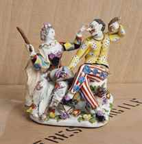 A MEISSEN GROUP OF HARLEQUIN AND COLUMBINE