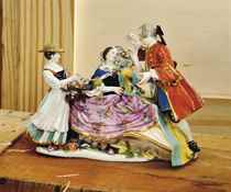 A MEISSEN GROUP OF THE 'MARCHAND DE COEURS'