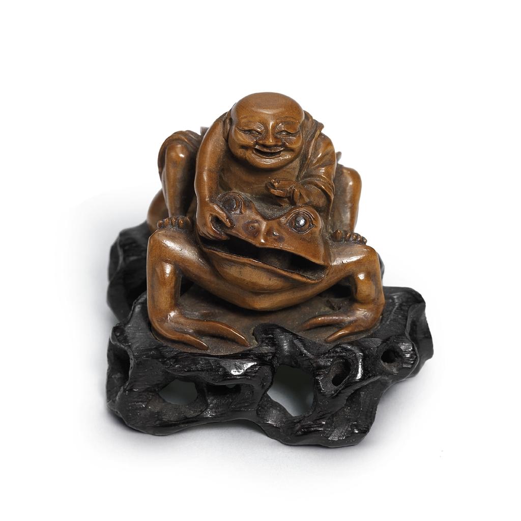 A small boxwood carving of liu hai and three legged toad