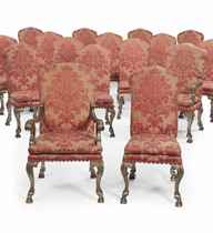 A SET OF SIXTEEN SILVERED DINING CHAIRS