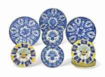 EIGHT DUTCH DELFT PLATES AND THREE CHARGERS