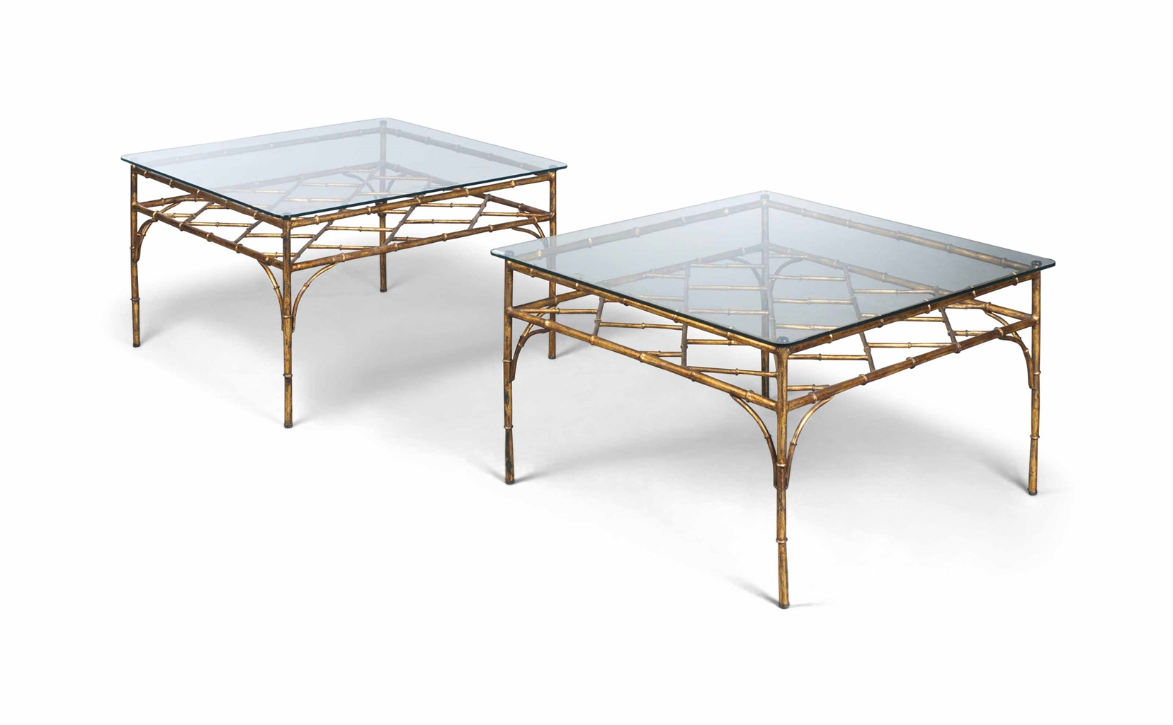 a pair of gilt iron and glass coffee tables modern
