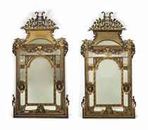 A PAIR OF MASSIVE GILTWOOD AND COMPOSITION MIRRORS