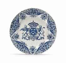 A DUTCH DELFT BLUE AND WHITE ARMORIAL PLATE (DE GRIEKSCHE A