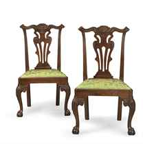 A PAIR OF CHIPPENDALE CARVED WALNUT SIDE CHAIRS