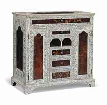 AN INDIAN ENGRAVED-IVORY AND TORTOISESHELL TABLE-CABINET