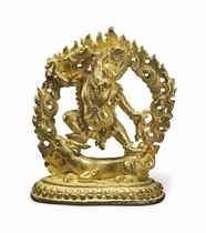 A small gold figure of Yamantaka