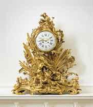 A FRENCH ORMOLU MANTLE CLOCK: 'PENDULE A LA GLOIRE DU ROI'