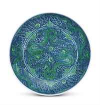 A RARE LARGE UNDERGLAZE-BLUE GROUND GREEN-ENAMELLED 'DRAGON