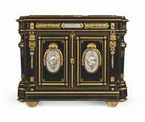 A FRENCH ORMOLU AND SEVRES STYLE PORCELAIN-MOUNTED EBONIZED