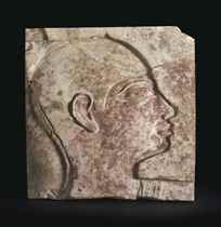 AN EGYPTIAN PAINTED LIMESTONE RELIEF FRAGMENT