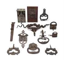 TWELVE IRON AND BRONZE DOOR KNOCKERS AND LOCKS