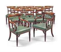 A SET OF FOURTEEN REGENCY MAHOGANY DINING-CHAIRS