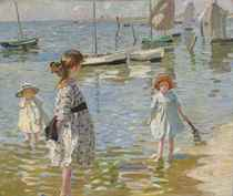 Children paddling on the sea shore