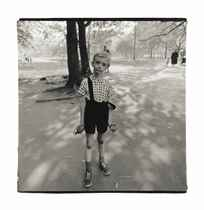 Child with a toy hand grenade in Central Park, N.Y.C., 1962